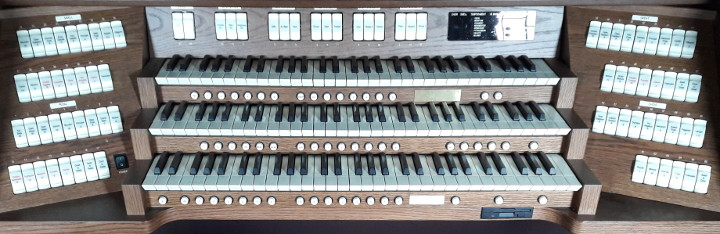 A typical three-manual digital organ in a house of worship